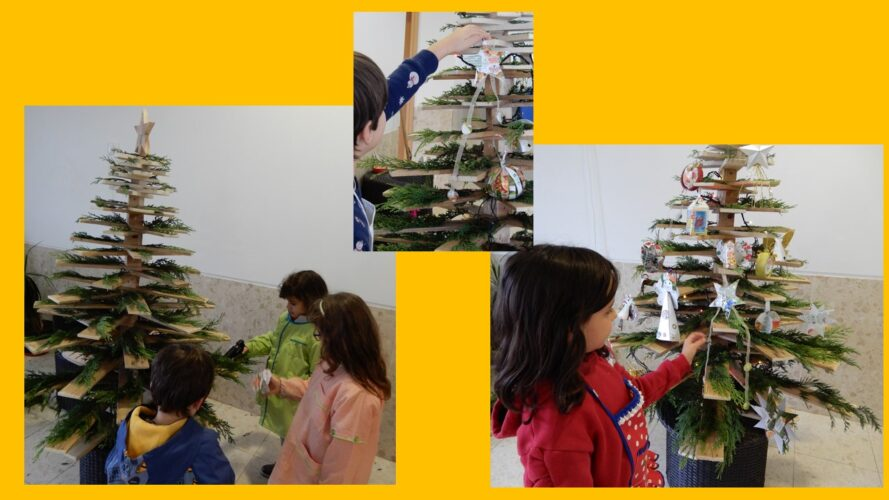 Decoração da árvore pelos alunos, com a ajuda de docentes e assistentes operacionais, utilizando os enfeites e ramos de cedros que foram usados também para decoração do recinto escolar.<br/>, pelos encarregados de educação com colaboração dos docentes, usand
