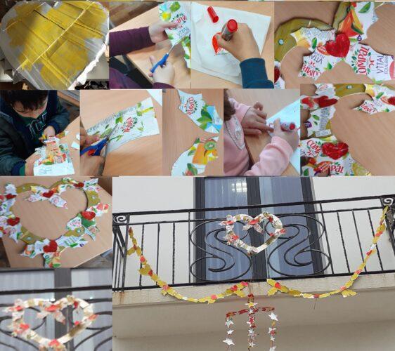 Reutilizando o coração amarelo do desafio do ano anterior, recortaram-se folhas de azevinho e pequenos corações para uma fita e grinalda em forma de coração. Alguns dos nossos enfeites de Natal também embelezaram o exterior da nossa escola. É Natal!